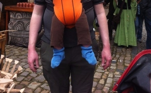 Infant wearing Zutano brand baby booties in blue in Baby Bjorn carrier
