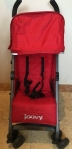 Joovy Groove Ultralight stroller in red shown from front view with shade fully extended