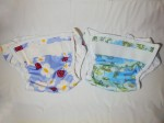 Two Bummis Super Whisper Wrap diaper covers shown side by side on a flat surface