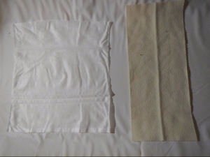 Bumkins flushable diaper liner shown next to Bummis flannel reusable diaper liner