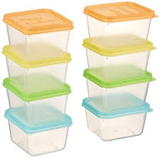EasyLunchboxes Mini Dippers set of 8 clear plastic containers for packing inside lunch containers with orange, yellow, green, and pale blue lids. Containers shown in two stacks of four