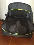 Brica Fold N Go Travel Booster Seat shown unfolded on the floor