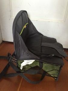 Brica Fold N Go travel booster seat shown from the side