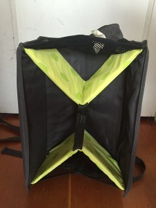 Support underneath a Brica Fold N Go travel booster seat unfolded