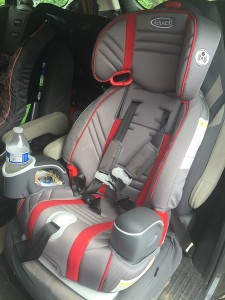 Graco Nautilus 80 Elite 3 in 1 booster seat installed in the bucket seat of a Mazda 5 micro van in the five point harness configuration