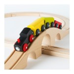 IKEA Lillabo wooden train starter set with black engine pulling three cars over a hill in a figure eight set up of wooden tracks