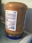 Natural peanut butter jar stored upside down in the refrigerator