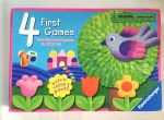 Four First Games box lid from Ravensburger with four flowers, a bird, a tree, a colored die, and one playing piece shown on the cover of the box