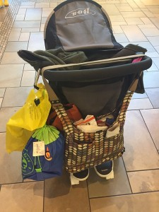 Orla Kiely baby diaper bag hanging off BOB motion stroller with Joovy Bumprider ride on board attached