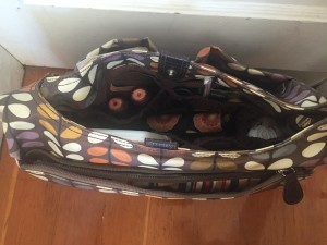 Orla Kiely Baby Changing diaper bag shown open with contents inside
