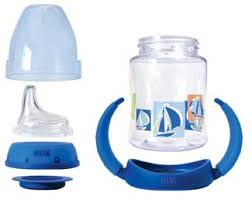 Nuk Learner Cup in 5 ounce size with all the included parts: cover, soft spout, lid, disk for sealing, cup, and removable handles