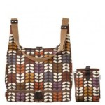 Orla Kiely baby bag diaper midi sling style in multi directional stem print with matching changing mat
