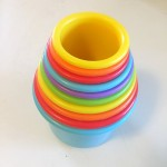 Ten stacking cups in rainbow colors shown nested