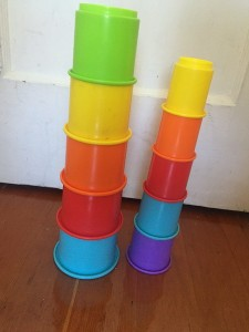 Stacking cups that also nest shown in two stacks of five side by side