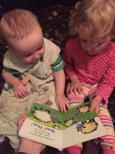 Toddler and infant reading Alphaprints Tweet Tweet book together