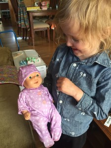 Hard newborn doll wearing Baby Stella pajamas