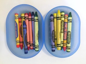 Crayons shown in two halves of a travel soap dish box case