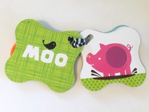 Touch and feel card by Infantino close up on pig textured cards with text shown on facing card