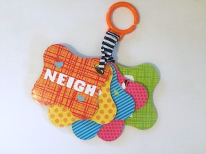 Backsides of five touch and feel textured cards on a strap by Infantino