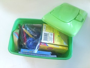 Art supplies for kids like crayons stored in an empty disposable wipe container