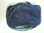 Eagle Creek Pack It Medium Cube filled with kid clothes and shown unzipped