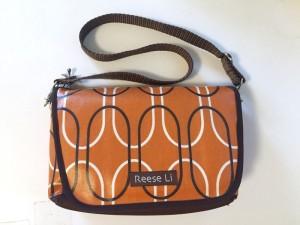 Reese Li changing clutch purse bag