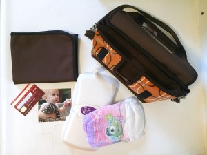 Reese Li changing clutch purse bag and contents of changing mat diaper wipes credit card photo shown
