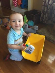 Toddler playing with Tonka steel mighty dump truck