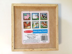Melissa and Doug wooden cube puzzle storage tray backside showing all six completed puzzle images
