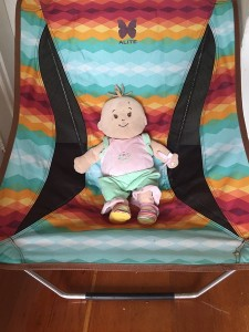 Baby Stella relaxing in Alite designs mayfly chair in southwest pattern