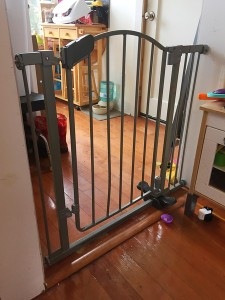 Summer Infant step to open baby gate in silver installed in doorway