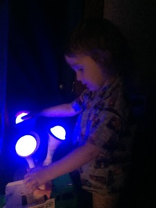 Child touching Boon Glo nightlight on the blue setting
