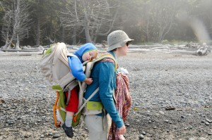 Toddler in Kelty Kids FC 3.0 backpack carrier on the back of a woman and infant in ring sling on front