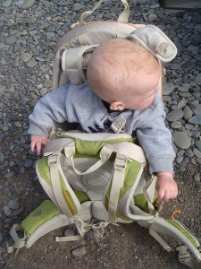 Infant riding in Kelty Kids FC 3.0 backpack carrier on the ground