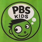 PBS Kids logo with child head and PBS in thought bubble with kids pointing up at it on blue background