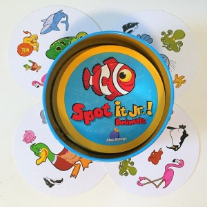 Spot It Junior animals version on top of four playing cards