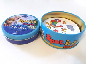 Spot It Jr animal and Frozen Elsa editions shown side by side in one closed and one open travel tin