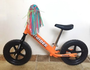 Strider balance bike with highest seat and handlebar adjustments