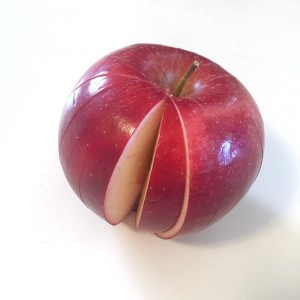 Sliced apple in apple shape missing one wedge piece
