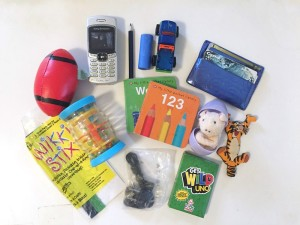 Contents of airplane busy box for young kids
