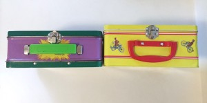 Curious george and incredible hulk metal lunch boxes side by side