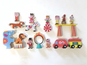 Pieces from Janod Story Box Circus laid out and arranged