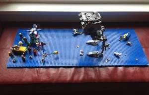 blue long Lego base plate with battle scene