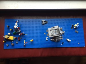 View of blue lego base plate with lego battle enacted from above