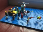 Blue Lego brick base plate with mini figures preparing for battle