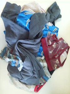 Kids clothes in pile with some turned inside out