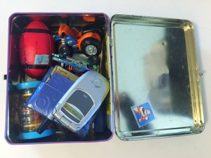 Metal lunch box with small toys inside to keep kids busy