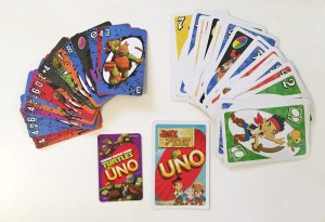 Uno card games in teenage mutant ninja turtles and jake neverland pirates side by side size comparison