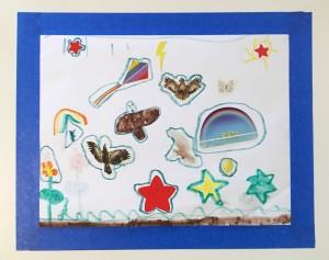 Child's art framed with blue painter's tape