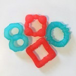 Bright Starts chill teething ring four in orange and turquoise in various shapes